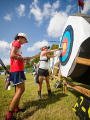 Women and girls are flocking to archery in recent years. Some experts attribute the sport's growth to films such as 'Hunger Games' and 'Brave.'