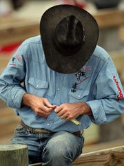 Cowboys don't use nail clippers. Professional cowboy Aaron Hudson uses a buck knife to cut his nails .