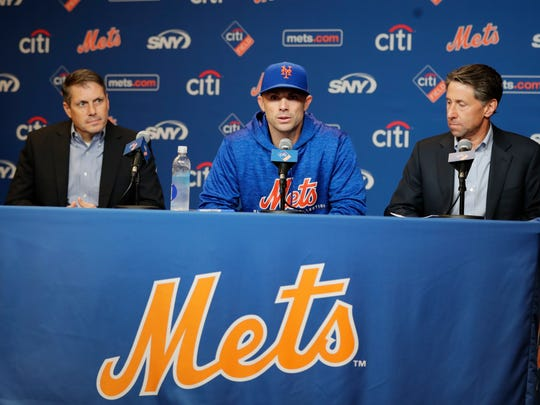 New York Mets assistant general manager John Ricco, left, and owner Jeff Wilpon, right, listen as third baseman David Wright speaks during a news conference before a baseball game against the Miami Marlins, Thursday, Sept. 13, 2018, in New York. (AP Photo/Frank Franklin II)