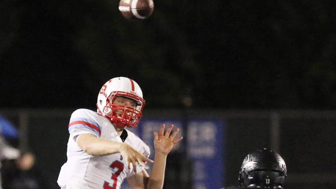South Salem's Gabe Matthews throws as the Saxons defeat West Salem 50-43 in overtime during a game on Friday, Sept. 25, 2015, in Salem.