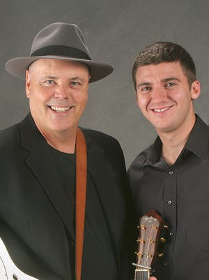 David Holt, left, and Joshj Goforth are helping to keep music traditional to Western North Carolina alive.