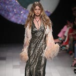 NYFW: Gigi Hadid loses a shoe on the runway, still walks like a pro at Anna Sui show