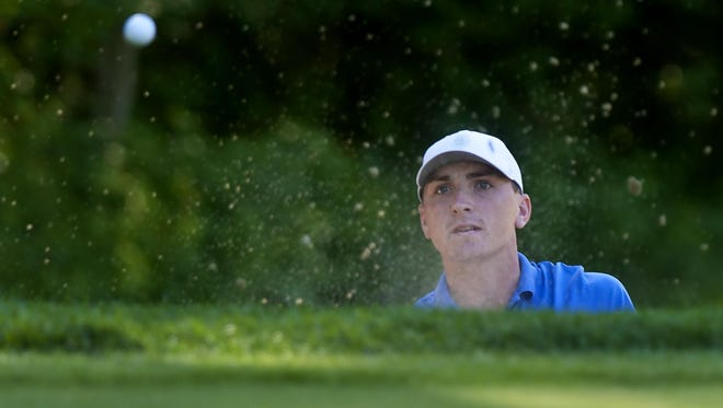 Evan Russell hits out of a bunker during the Vermont Amateur golf championship at Burlington Country Club last year.