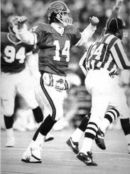 Buffalo Bills quarterback Frank Reich celebrates as