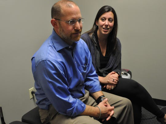 Bradley and Mimi Kirzner sit at his chiropractic office, the Alexandria Spine & Rehab Center, as they talk about relocating to Alexandria following Hurricane Katrina.