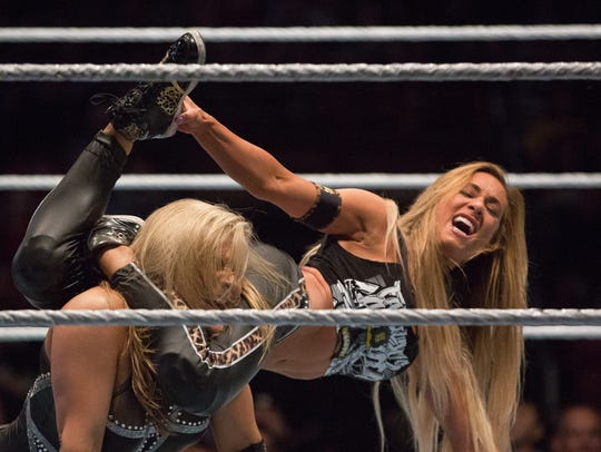 Carmella, right, performs a Code of Silence move on Natalya Neidhart during a WWE Smackdown Live event in February 2017.