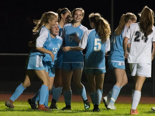South Burlington celebrates a goal during the girls
