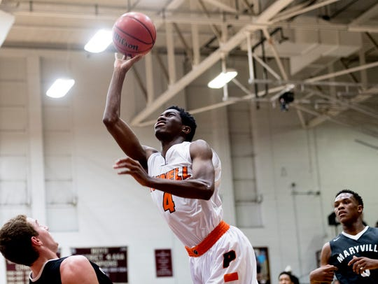 Powell's Desmond Billingsley (4) shoots a layup during