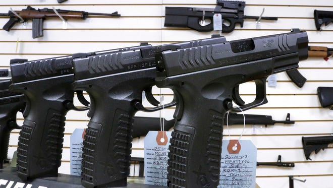 An assortment of firearms for sale at Capitol City Arms Supply in Springfield, Ill.