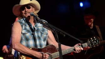 Alan Jackson surprises fan with a retro look from 25 years ago at the CMA Theater at the Country Music Hall of Fame and Museum during the final night of his Artist in Residence series on October 22, 2014 in Nashville, Tennessee.