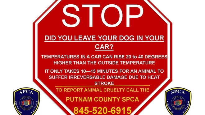 A sign provided by Putnam's SPCA warning people that it's illegal to leave a pet in a hot car.