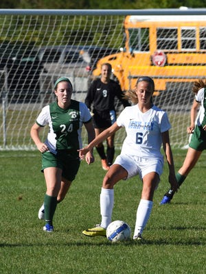 John Jay's Dannen Quesnel, center, takes possession of the ball while Cornwall's Brynne Growney, left, and Olivia Davet, right, defend during Monday's game.