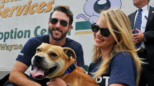 Cy Young award winning pitcher Justin Verlander with girlfreind Kate Upton, a Holy Trinity graduate, supermodel and actress, find a new friend during Wednesday's Grand Slam Dog Adoption Event held at the Space Coast stadium before the Washington Nationals game.The dogs are from the Brevard County Sheriff's Animal Services.