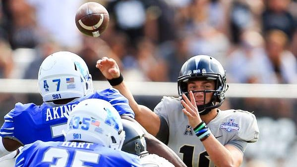 UCF Knights quarterback McKenzie Milton (10) throws a touchdown pass to wide receiver Dredrick Snelson (not pictured) during the first half at Spectrum Stadium.