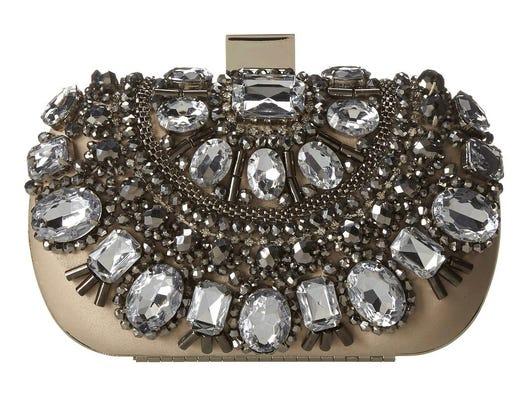 Embellished pieces spice up wardrobe basics. Enroelid clutch by Aldo, $50 at zappos.com. (Gannett/File)