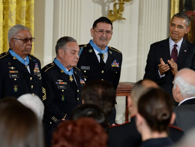President Obama applauds three Medal of Honor recipients, Army Sgt. 1st Class (Ret.) Melvin Morris, from left, Army Master Sgt. (Ret.) Jose Rodela, and Army Sgt. (Ret.) Santiago Erevia during the White House ceremony on March 18.