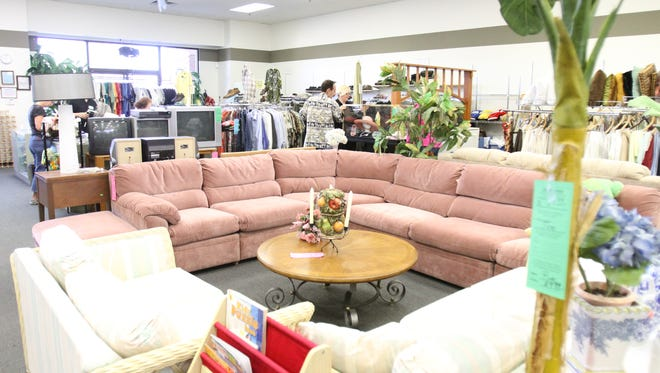 Furniture, clothing, and linens are some of the items displayed for shoppers on Sunday, Feb. 5, 2012, inside the Angel View Resale Boutique on Highway 111 in La Quinta.