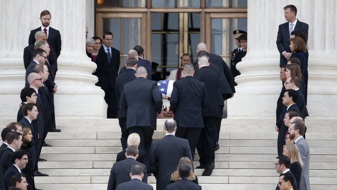 The body of Justice Antonin Scalia arrives at the Supreme Court on Feb. 19, 2016.
