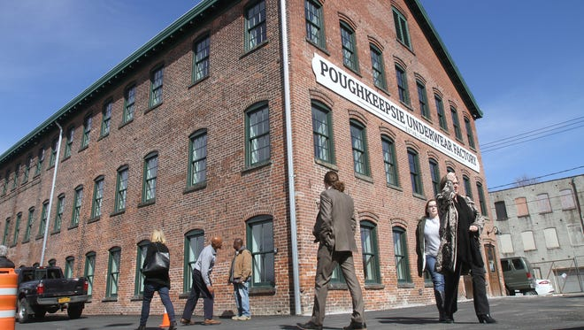Visitors arrive for the grand opening celebration of the Poughkeepsie Underwear Factory on North Cherry Street in downtown Poughkeepsie March 30, 2017.