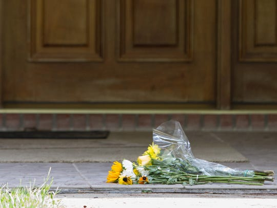Flowers sit on the front porch of Dan Markel's Trescott Drive home in July 2014, days after the law professor was killed in his garage.