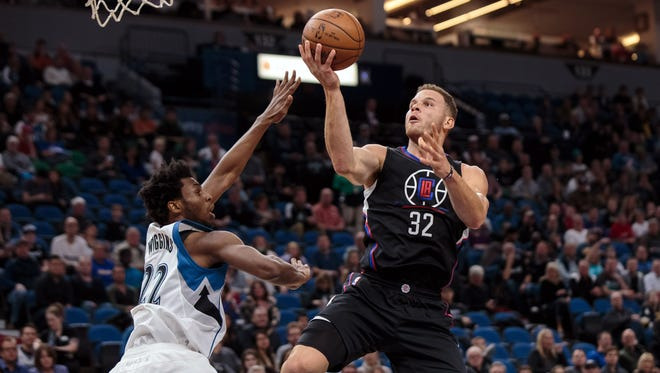 Los Angeles Clippers forward Blake Griffin (32) shoots in the first quarter against the Minnesota Timberwolves guard Andrew Wiggins (22) at Target Center.