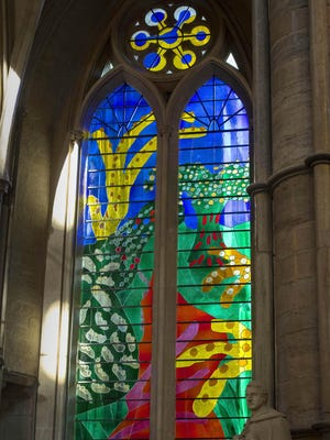 A view of The Queen's Window, a new stained glass window at Westminster Abbey designed by David Hockney and created by Barley Studio York.