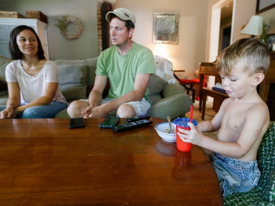 Lane Atwell eats breakfast as his parents, Travis and Christin Atwell, describe the dog attack that injured Lane, his sister Evy and Christin.