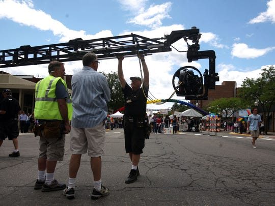 """A camera crane is moved into position before shooting the gay pride parade scene in the Lifetime movie """"Prayers for Bobby,"""" for which Royal Oak became San Franscisco. Film incentives are an issue before the Legislature during the lame-duck session."""