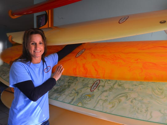 Kelly O'Hare, daughter of Pat O'Hare, stands by a collection