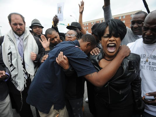 Six Baltimore police officers face criminal charges in Freddie Gray's death