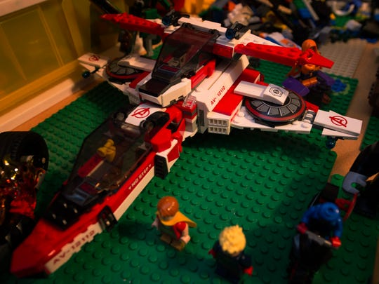 The Collins family enjoys playing with Legos in their