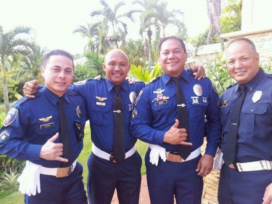 Elbert Piolo, second from left, is shown with fellow
