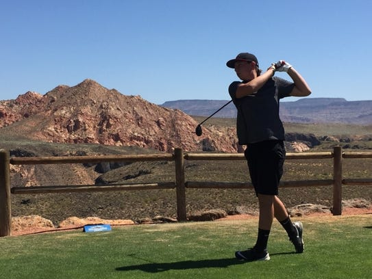 A golfer hits off the back nine tees at Sky Mountain