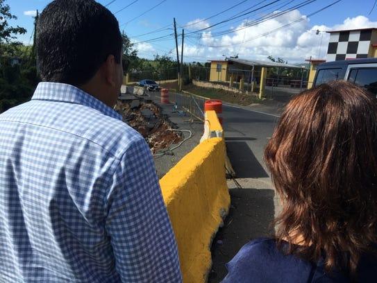 Perth Amboy Mayor Wilda Diaz (right) assesses damage