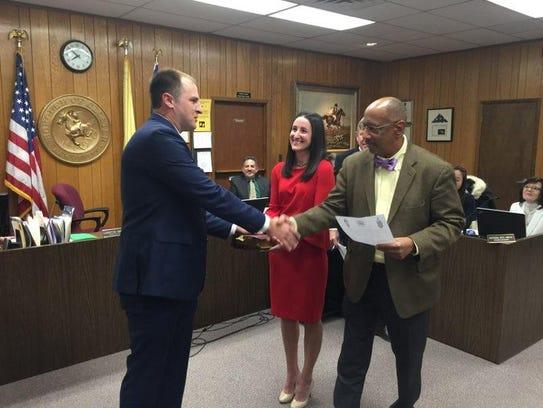 Assemblyman Gordon M. Johnson shakes Scott Devlin's