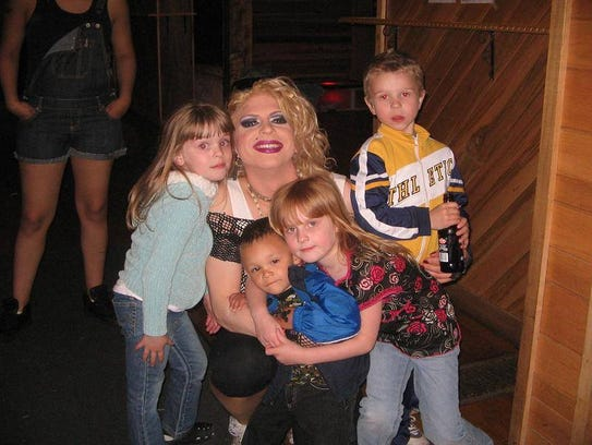 Shown here performing as Madonna, Katrina will read