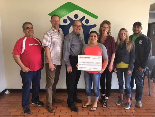 Local State Farm agents present a $5,000 donation to