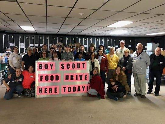 Nutley Family Service Bureau volunteers gather to sort items collected during the local Boy and Cub Scouts' 2018 Scouting for Food campaign. The donated items have been given to the NFSB food pantry.