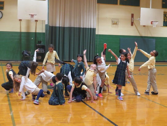 Third graders show off their dance moves during the