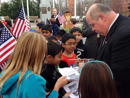 Parsippany Mayor James Barberio signs the programs