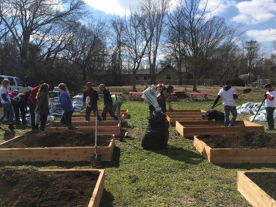 Volunteers Unite For Community Garden