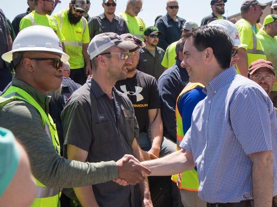 Gov. Scott Walker shakes hands with Michels employees