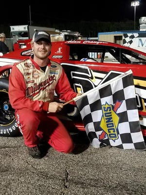 Adam Crawford celebrates after winning at Five Flags Speedway over the weekend.