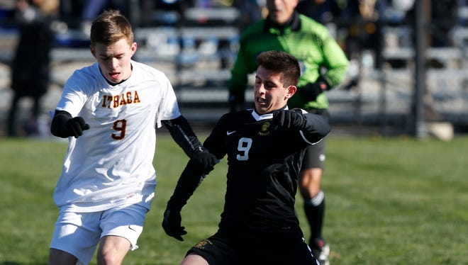 Ithaca's Mason Todhuter and McQuaid Jesuit's Nick Pierleoni battle for the ball during Saturday's Class AA state semifinal at Middletown High School on Nov. 11, 2017.