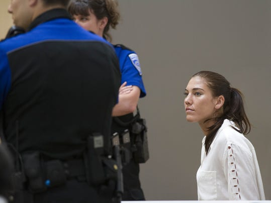 U.S. women's soccer team goalkeeper Hope Solo appears in Kirkland Municipal Court on Monday, June 23, 2014, in connection with her domestic violence arrest at her sister's home in Kirkland, Wash. (AP Photo/Pool, The Seattle Times, Mike Siegel, Pool)