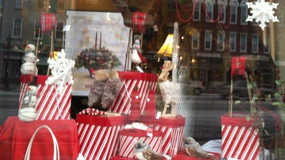 The window of Arjuna Florists on Main Street in Brockport.