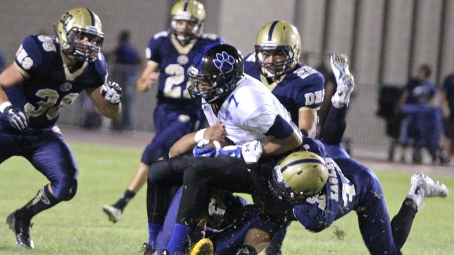 Lions' Kavonte Kinney (7) is tackled by Golden Eagles defenders during Friday's season opener.