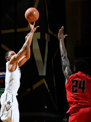 Vanderbilt forward Jeff Roberson (11) shoots a three point shot over Austin Peay forward Averyl Ugba (24) during the first half at Memorial Gymnasium Friday, Nov. 10, 2017 in Nashville, Tenn.