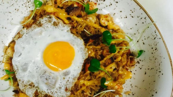 The crawfish fried rice is one of many brunch dishes served at Dark Roux.