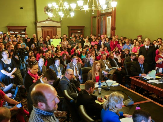 Planned Parenthood supporters and opponents pack a Senate committee meeting on SF 2, a bill that would defund Planned Parenthood Tuesday, Jan. 31, 2017.